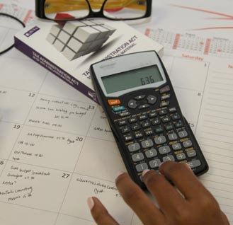 Calculator-tax-act-booklet-hand